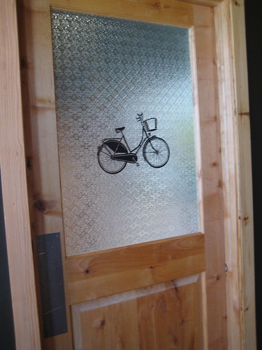 bike on women's bathroom door