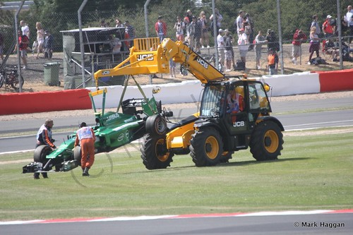 Marcus Ericsson's Caterham is recovered after spinning off during Free Practice 1 at the 2014 British Grand Prix