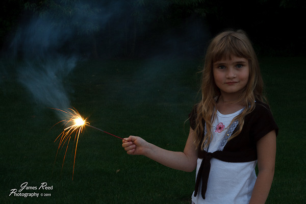 The little one kicks of the firework festivities with a sparkler.