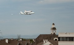 Discovery and chase plane over the Clocktower Shopping Center