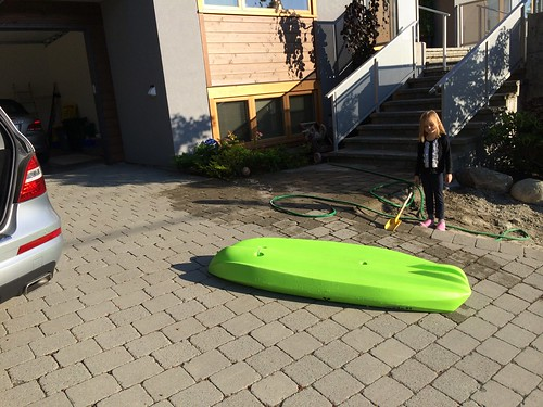 Cleaning the kid's kayak by Marc van der Chijs, on Flickr