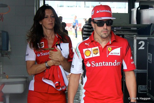Fernando Alonso returns to the paddock after the Drivers' Parade at the 2014 German Grand Prix