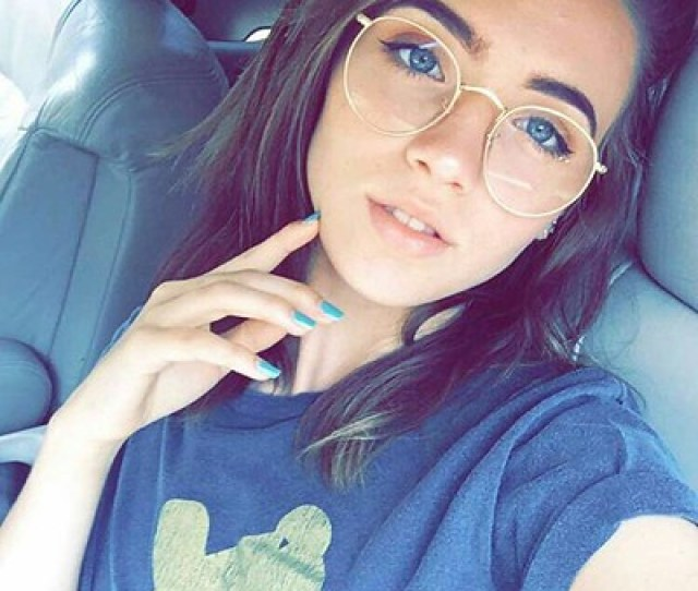 Sexy Girl With Big Round Glasses Takes A Seatbelt Selfie Squinting