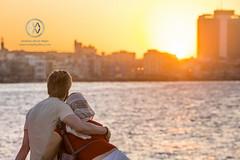 A couple enjoys the sunset in Havana.