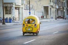 A unique motor taxi takes people around Havana.