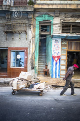 A man sits on his porch in Havana.