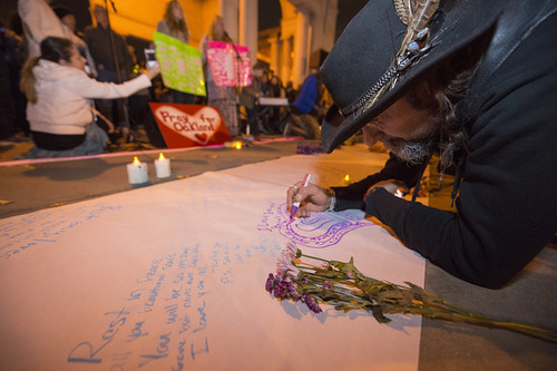 People gathers for a candle vigil in remembrance of the victims in the Ghost Ship warehouse fire at Lake Merritt Oakland, California on December 5, 2016