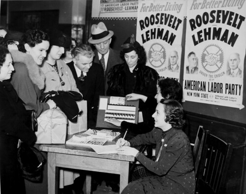 Voter registration table surrounded by American Labor Party posters supporting Franklin D. Roosevelt and Herbert Lehman, 1940