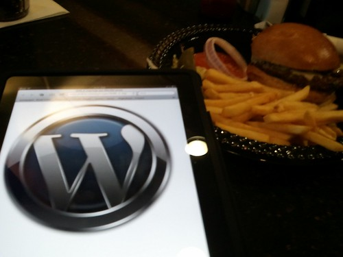 WordPress logo next to a burger waiting for a flight home to seattle