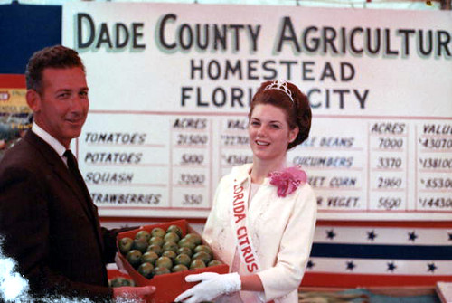 Florida Citrus Queen LaVoyce Leggett and Mayor William Dickinson With a Box of Limes at the Dade County Agricultural Fair: Homestead, Florida