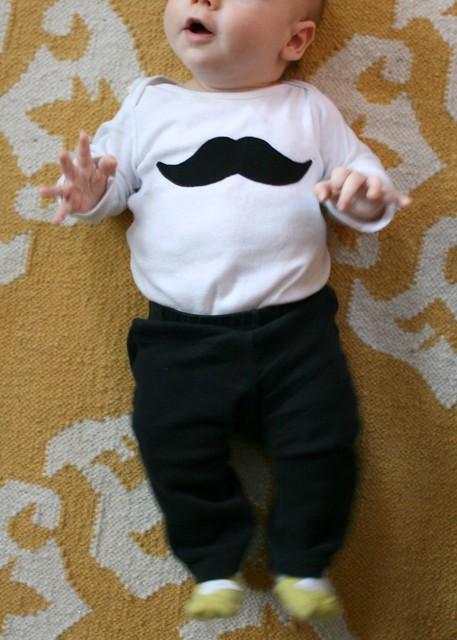 old timey moustache onesie