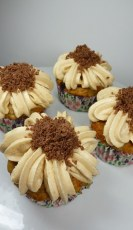 Banana Cupcakes with butterscotch chocolate cups w. Caramel frosting & chocolate shavings