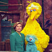 Photograph of First Lady Hillary Rodham Clinton Posing on the Big Bird Nest Set with Big Bird...