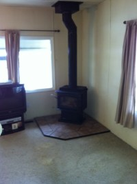 Corner of Living room with wood stove | Explore 1525 COLD ...