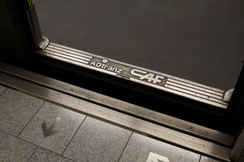 ADtranz CAF badge on the doorstep of an A-stock train