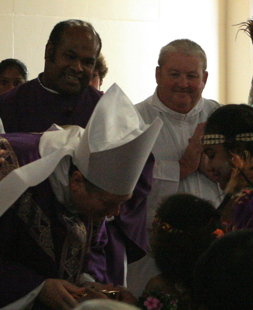 Bishop Anthony receiving the gifts, with acolyte assisting