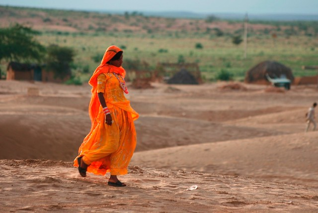 Rajasthani girl in tangerine traditional attire