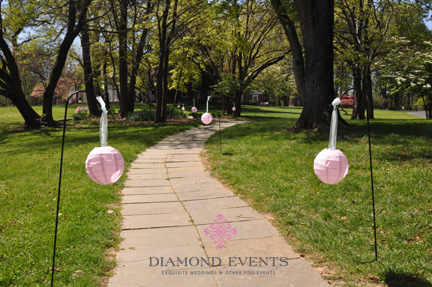 Paper lanterns lining pathway to wedding ceremony
