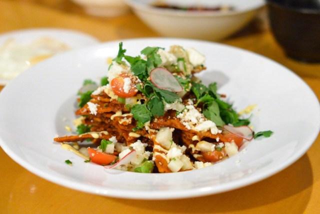 Wild Boar Chilaquiles guajillo, roasted carrot crema, queso casera, fried egg