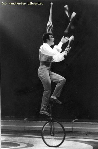 Unicyclist juggling, Belle Vue Circus, 1960