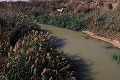 Jordan River flowing near site of Baptism of Saint John. by wblyons