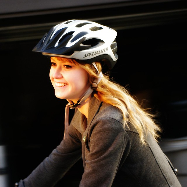Girl on Bike with late evening sun in her face