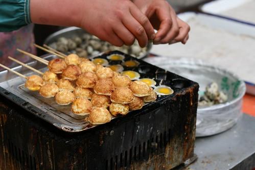 Making quail egg kebabs