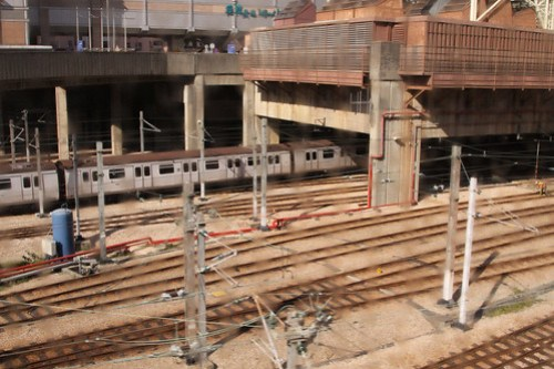 Train entering the east end of the shed at Kowloon Bay depot: buildings on the podium as with every other MTR depot