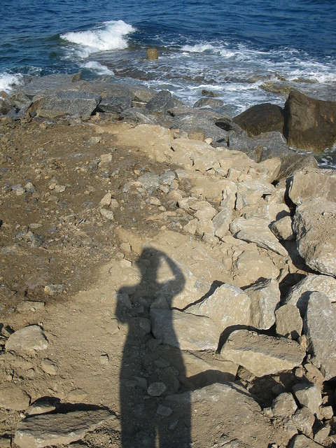 My shadow on rubble in Armenistis, Ikaria, Greece