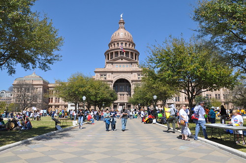 austin capitol with crowd outside