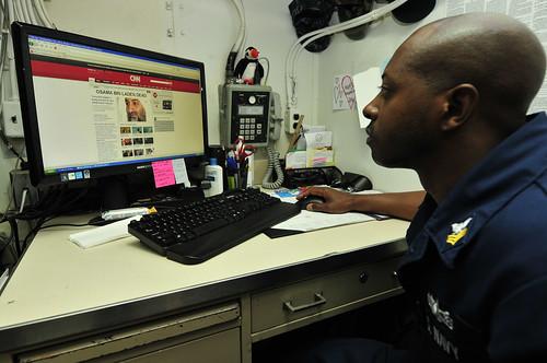 Sailor reads news about Osama Bin Laden's death.