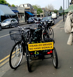 disabled driver no hand singles sign tricycle Turnham Green Terrace Chiswick London 18th April 2010 13:32.43pm