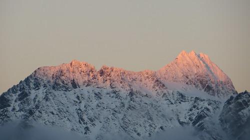 sunrise hits the peaks