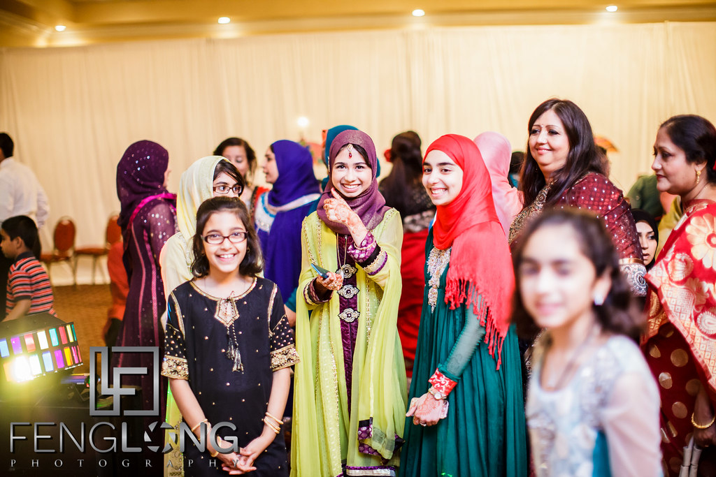 Guests in Hijabs smile during a candid photo
