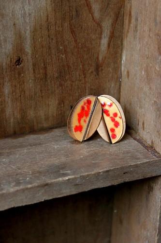 orange enamel & copper clip-on earrings by denise carbonell