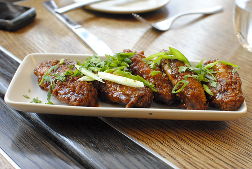 Tamarind chicken wings, spring onions, coriander
