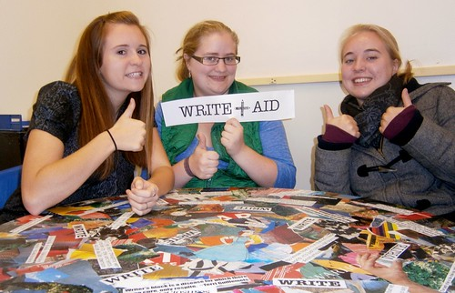 Three students give the thumbs up sign in the Deer Isle-Stonington High School Writing Center.