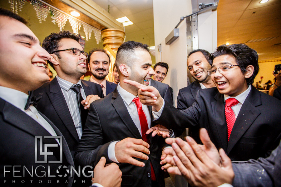 Groom bartering at entrance