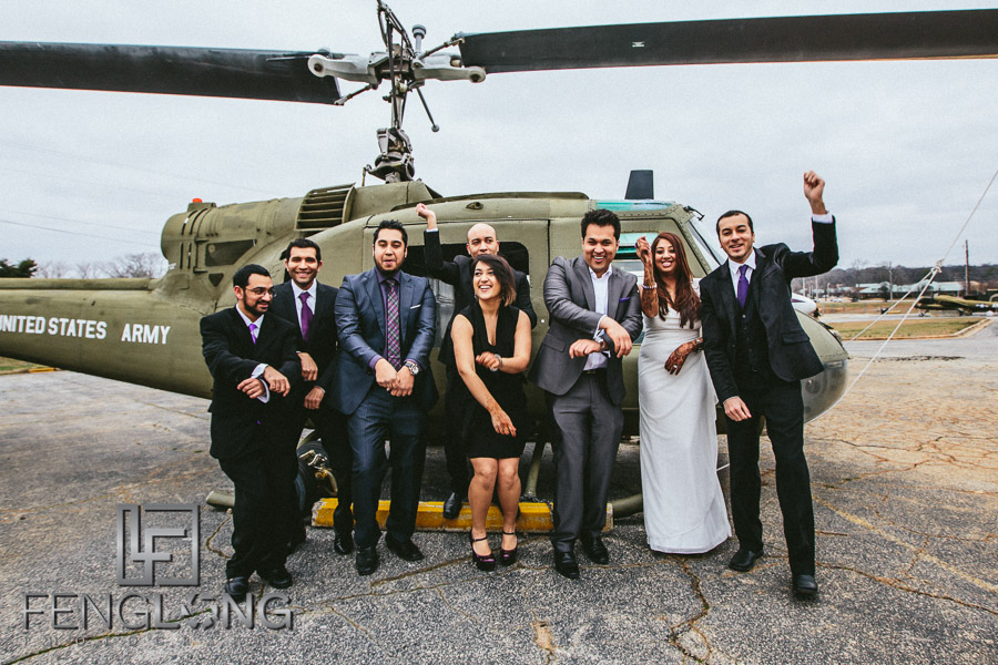 Family in front of helicopter for fun gangnam style photo