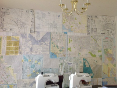 My living room wall: a collection of maps of all of the states my step-dad drove through from Wisconsin to Santa Cruz in 1989