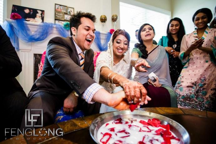 Kanwal and Ali play the Khoba Khobi ceremony as part of their Atlanta Ismaili Indian wedding