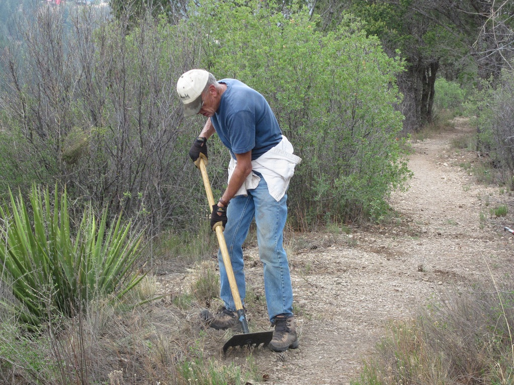 New Mexico Rails-to-Trails volunteer grooming Switchback Trail