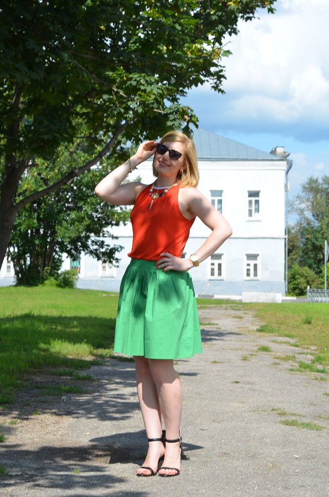 red top green skirt