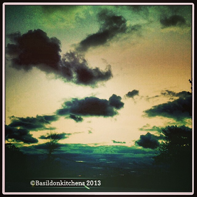 Oct 7 - what I saw today {the wind blowing away the last of today's storm clouds} #fmsphotoaday #clouds #sunset