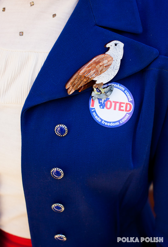 "Erstwilder Brahminy Bryan brooch stands in for a bald eagle with an ""I Voted"" sticker on a patriotic election day outfit"
