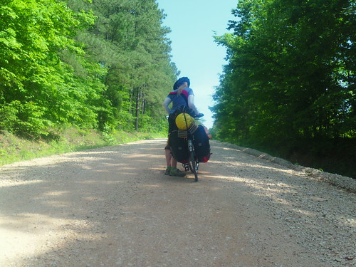 hannah pushing bike up hill in TN