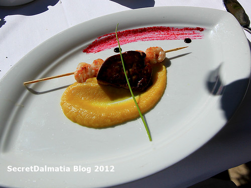 Scampi on apple cream on reduction of monkfish and foie gras