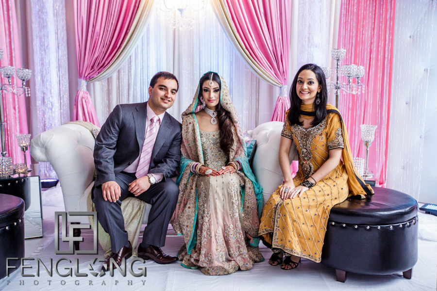 Bride and groom take photos with guests