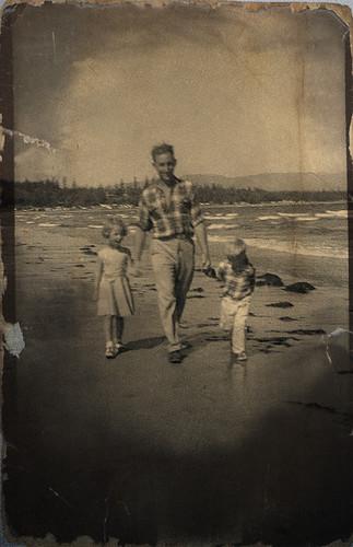 me, dad and Pattycakes at a deserted beach, 1959