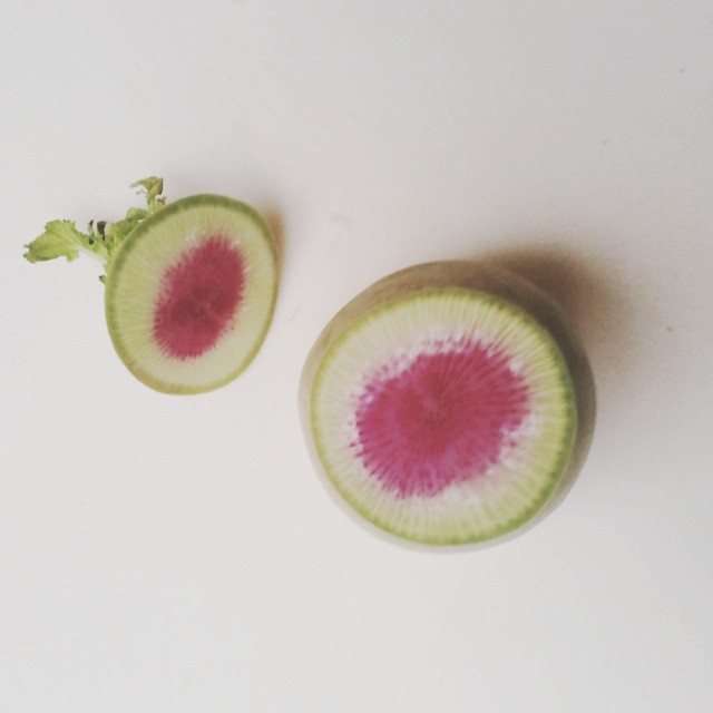 Sliced into this thinking it was a turnip. Surprise, it's not. #onthetable #vegetarian #radish #veggie #pinkandgreen